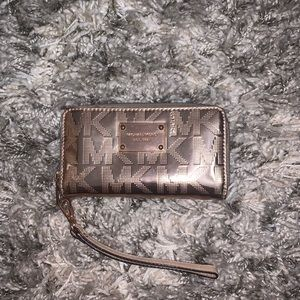 MK small rose gold wristlet